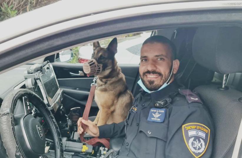 An Israel police officer with famous Israeli actor Shlomo Vishinsky's dog Lisa.  (photo credit: POLICE SPOKESPERSON'S UNIT)