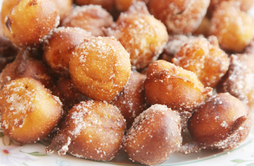 Bunuelos are small balls of fried dough with a sweet or salty filling.  (photo credit: THE NOSHER/JTA)