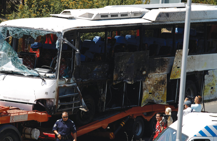 A bus shows the aftermath of a Hezballah attack that killed eight Israelis (photo credit: STOYAN NENOV/REUTERS)
