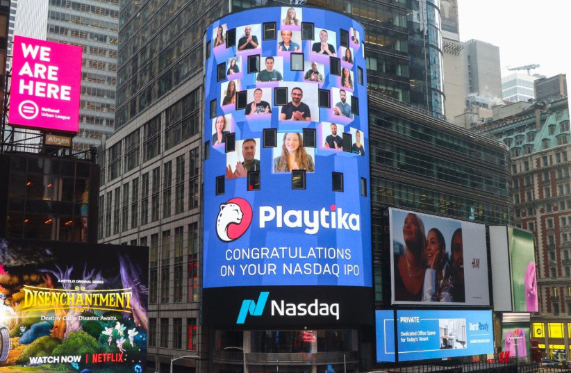 Playtika logo projected in times square during the IPO opening ceremony in New York (photo credit: Courtesy)