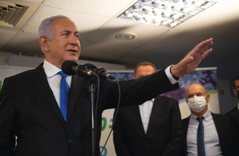PRIME MINISTER Benjamin Netanyahu visits a coronavirus vaccination facility in Nazareth last Wednesday. (Gil Eliyahu/Reuters) (photo credit: GIL ELIYAHU/REUTERS)