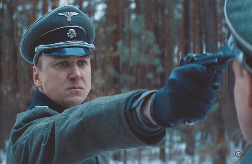 LARS EIDINGER plays a Nazi officer at a concentration camp in 'Persian Lessons' in 2019. (Courtesy HyperFilms) (photo credit: Courtesy)