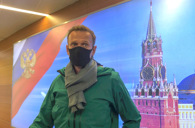 Russian opposition leader Alexei Navalny speaks with journalists upon the arrival at Sheremetyevo airport in Moscow, Russia January 17, 2021.  (photo credit: REUTERS/POLINA IVANOVA)