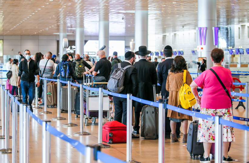 Passengers at the Departure hall at the Ben Gurion Airport, near Tel Aviv on December 14, 2020.  (photo credit: YOSSI ALONI/FLASH90)