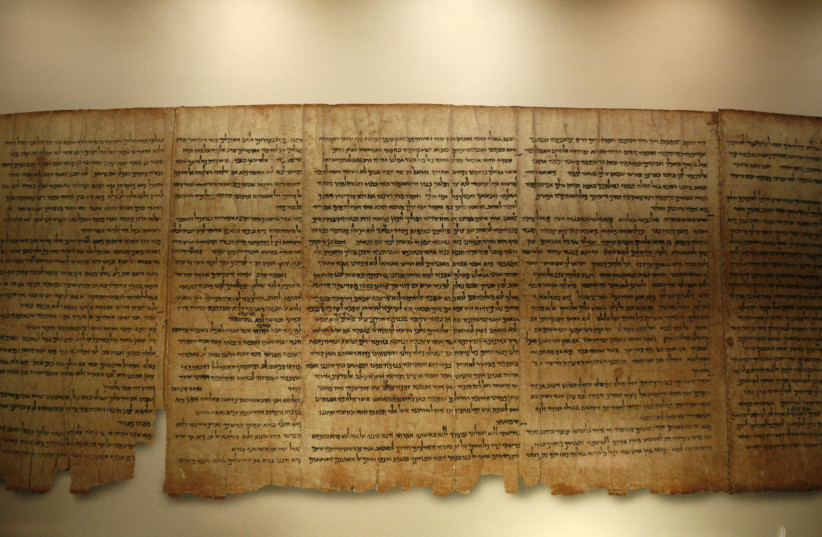 A facsimile of the Isaiah Scroll, one of the Dead Sea Scrolls, is displayed inside the Shrine of the Book at the Israel Museum in Jerusalem September 26, 2011. Developed in partnership with Google, the Israel Museum on Monday launched its Dead Sea Scrolls Digital Project, allowing users to explore t (photo credit: BAZ RATNER/REUTERS)