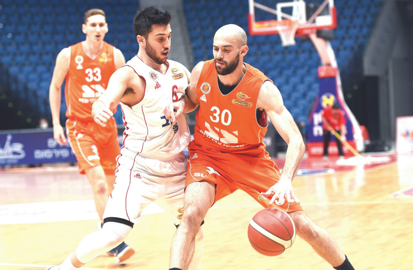 NIMROD TISHMAN (30) and Maccabi Rishon Lezion were too strong for Tamir Blatt and Hapoel Jerusalem on Sunday night, pulling out a 79-73 Balkan League win.  (photo credit: BERNEY ARDOV)