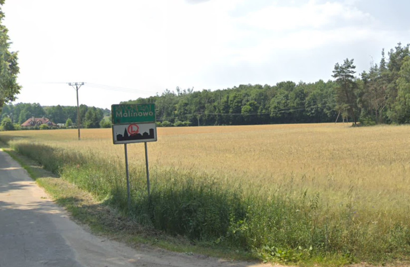 A sign at the entrance to the village of Malinowo, Poland (photo credit: GOOGLE MAPS)