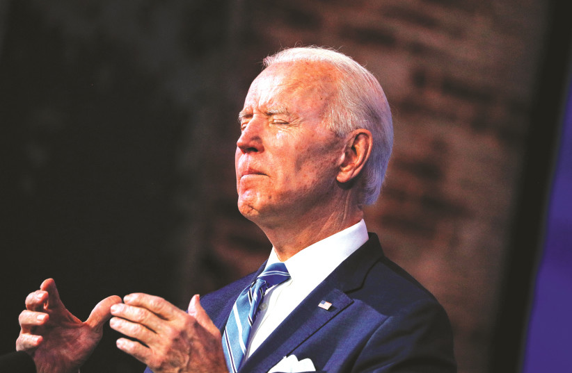 JOE BIDEN reacts while delivering remarks last week at The Queen theater in Wilmington, Delaware during a televised speech on the current economic and health crises. (photo credit: TOM BRENNER/REUTERS)