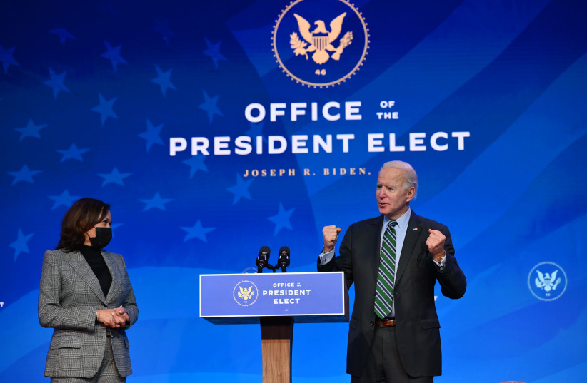 President-elect Joe Biden and Vice President-elect Kamala Harris at an event to announce nominees for their science team in Wilmington, Del., Jan. 16, 2021. (Angela Weiss/AFP via Getty Images) (photo credit: GETTY IMAGES)