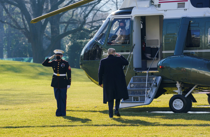 US President Donald Trump boards Marine One as he departs the White House on travel to visit the US-Mexico border Wall in Texas, in Washington, US, January 12, 2021.  (photo credit: REUTERS/KEVIN LAMARQUE/FILE PHOTO)