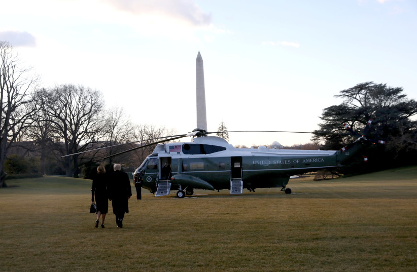 US President Donald Trump and first lady Melania Trump depart the White House to board Marine One ahead of the inauguration of president-elect Joe Biden, in Washington, US, January 20, 2021. (photo credit: LEAH MILLIS/REUTERS)