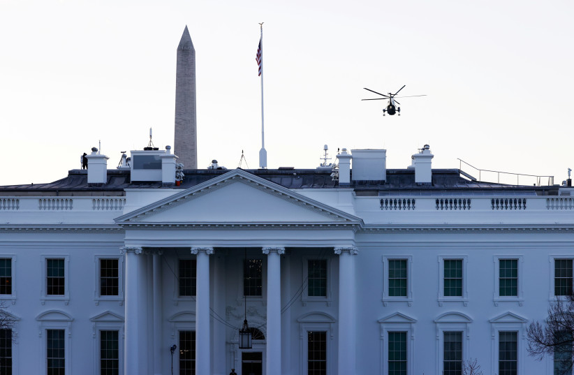 US President Donald Trump departs the White House aboard Marine One ahead of the inauguration of President-elect Joe Biden, in Washington, US, January 20, 2021. (photo credit: ANDREW KELLY / REUTERS)