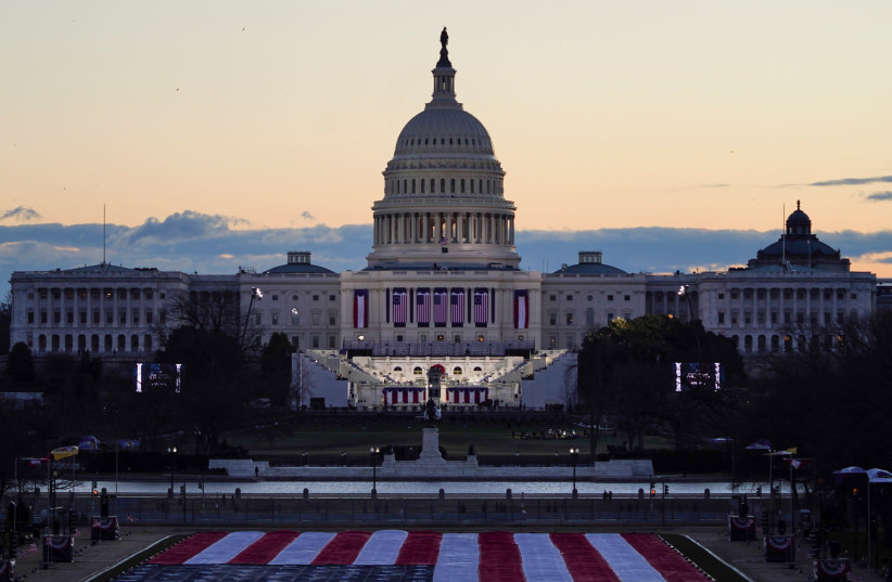 """The """"Field of flags"""" is seen on the National Mall in front of the U.S. Capitol building ahead of inauguration ceremonies for President-elect Joe Biden in Washington, US, January 20, 2021. (photo credit: REUTERS/ALLISON SHELLEY)"""