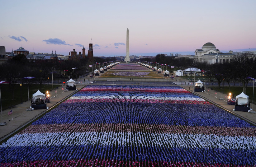 "The ""Field of flags"" is seen on the National Mall in front of the U.S. Capitol building ahead of inauguration ceremonies for President-elect Joe Biden in Washington, US, January 20, 2021. (photo credit: REUTERS/ALLISON SHELLEY)"