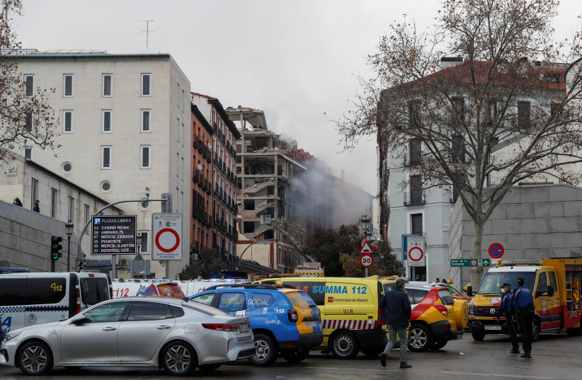 Smoke rises from the site of an explosion in Madrid downtown, in Madrid Spain January 20, 2021. (photo credit: REUTERS/SUSANA VERA)