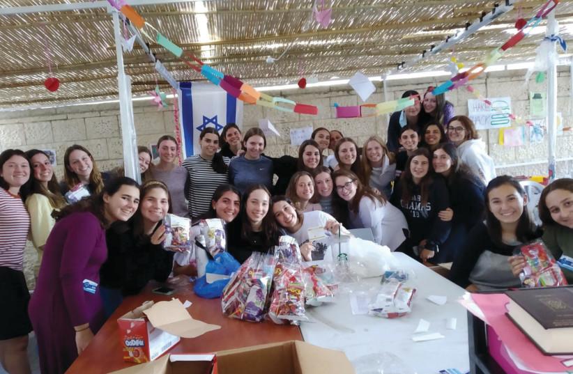MAKING QUARANTINE sweeter for kids with Simhat Torah candy (photo credit: KEDMA)