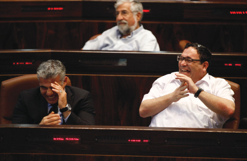 YAIR LAPID (left) and Shai Piron share a good laugh at the Knesset (photo credit: HADAS PARUSH/FLASH90)