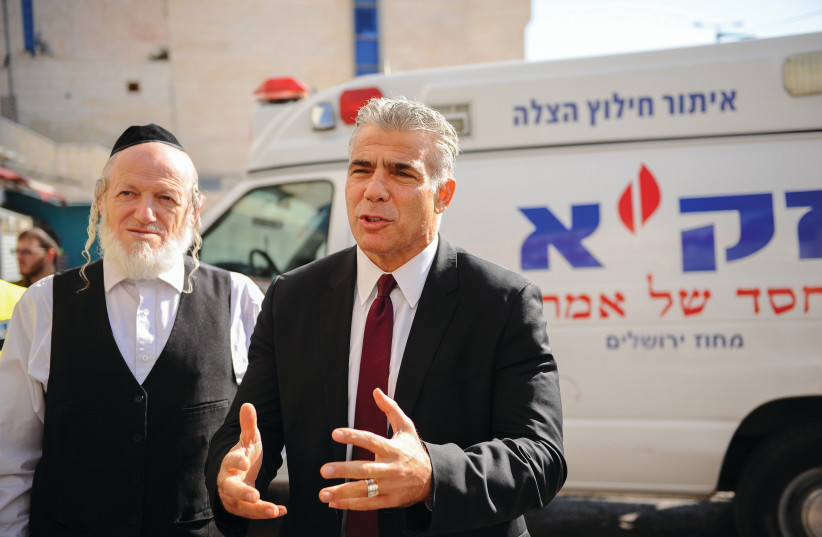 YEHUDA MESHI-ZAHAV (at left, with Yair Lapid) issued a strong call to haredim this week (photo credit: MENDY HECHTMAN/FLASH90)