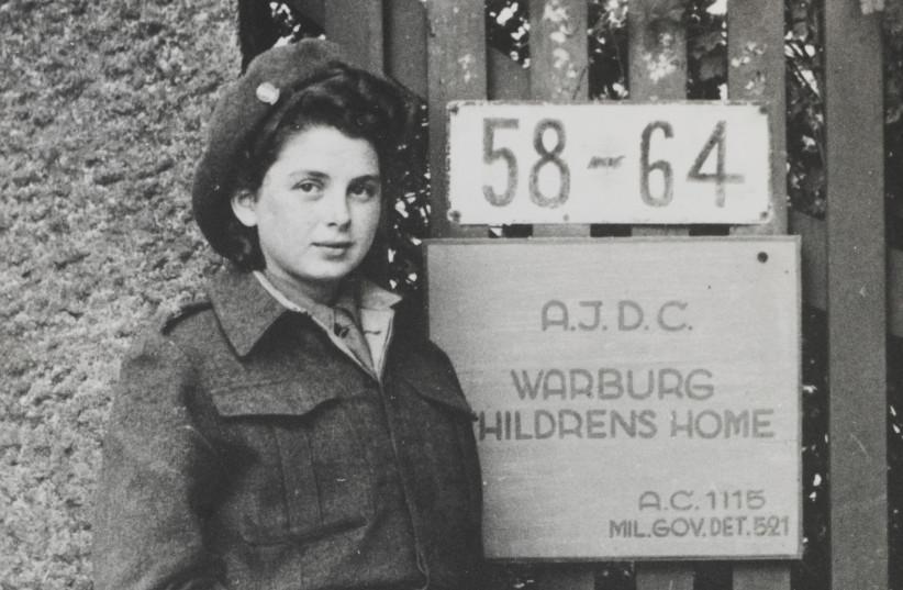 RENIA BAAF (later Renee Kochman) at the entrance gate of the children's home in Blankenese, Hamburg, Germany, 1946. (photo credit: YAD VASHEM PHOTO ARCHIVES)