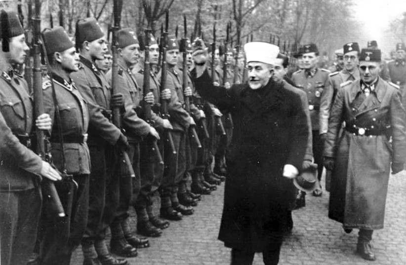 Al-Husseini greeting Bosnian Waffen-SS volunteers with a Nazi salute, November 1943 (photo credit: BUNDESARCHIV BILD 146-1980-036-05 / UNKNOWN AUTHOR / CC-BY-SA 3)