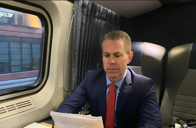 Israeli Ambassador to the UN Gilad Erdan working on a train. Erdan met US President Joe Biden on the train and discussed Israel-US relations. (photo credit: Courtesy)
