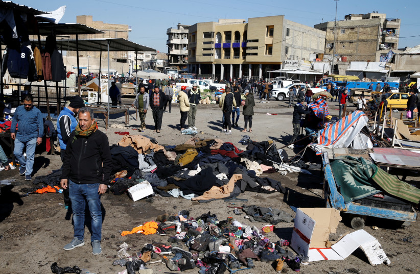 The site of a twin suicide bombing attack in a central market is seen in Baghdad (photo credit: REUTERS)