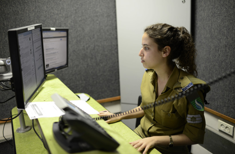 Radio broadcasters seen in the offices of Galei Tzahal, the national IDF radio station, in Jaffa, on March 27, 2014. (photo credit: TOMER NEUBERG/FLASH90)