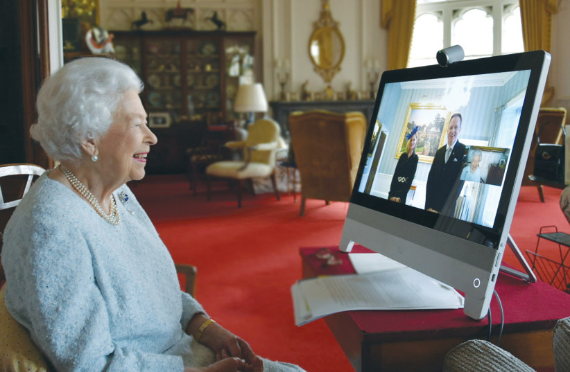HER MAJESTY Queen Elizabeth II conducts a virtual audience with a new ambassador at Windsor Castle. (photo credit: COURTESY BUCKINGHAM PALACE)