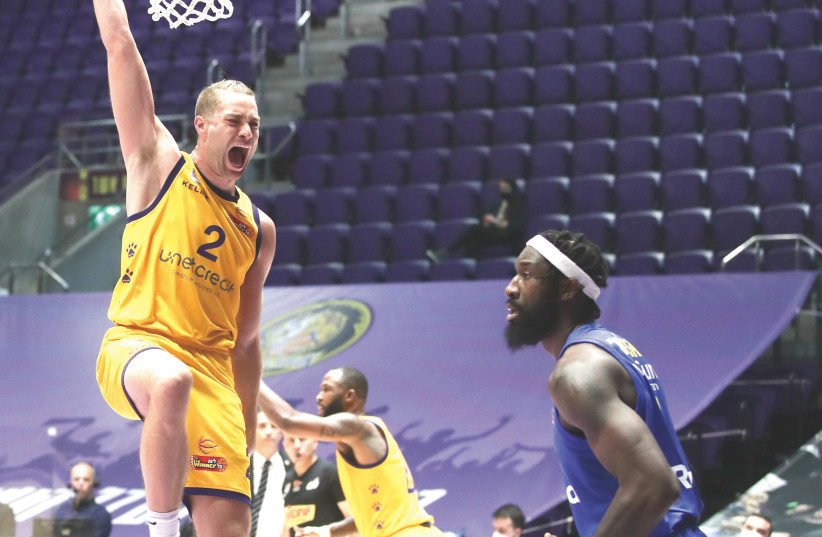 WILLY WORKMAN and Hapoel Holon progressed to the Champions League playoffs on Wednesday night. (photo credit: DANNY MARON)