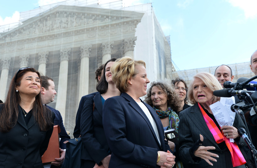 Edie Windsor, right, an 83-year-old lesbian widower, makes a statement to the media as her lawyer Roberta Kaplan, left, looks on in front of the Supreme Court in Washington, March 27, 2013. (photo credit: AFP/JEWEL SAMAD VIA GETTY IMAGES)