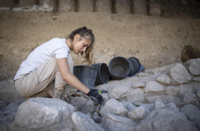 Valeria Fenik works at a digging site in the Givati Parking Lot excavation grounds, at the City of David National Park, on July 22, 2019. The most recent digging site currently under work is attributed to the Muslim, Byzantine, and early Roman periods.  (photo credit: HADAS PARUSH/FLASH90)
