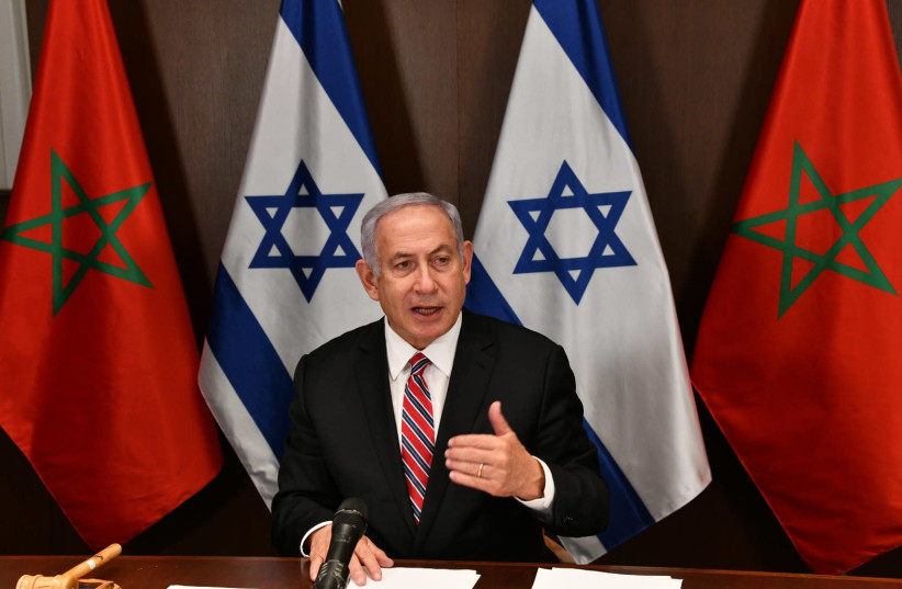 Prime Minister Benjamin Netanyahu and the government's cabinet formalizes the normalization agreement with Morocco. (photo credit: CHAIM TZACH/GPO)