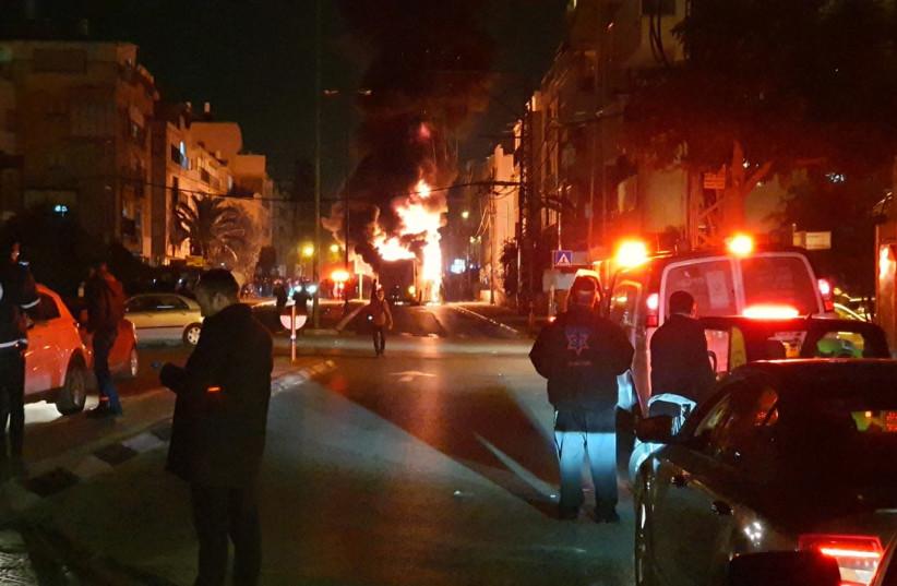 Haredi rioters torch bus in Bnei Brak, Jan. 24, 2021 (photo credit: MOTTI UNNA/MDA)