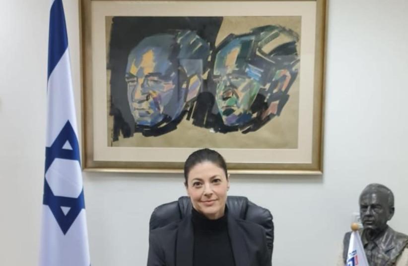 Merav Michaeli sitting on the party leader's chair at her office in Tel Aviv (photo credit: MICHAELI'S OFFICE)