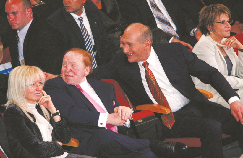 SHELDON ADELSON (center), his wife Miriam, and then-prime minister Ehud Olmert attend a conference in Jerusalem in 2008. (photo credit: OLIVIER FITOUSSI/FLASH90)