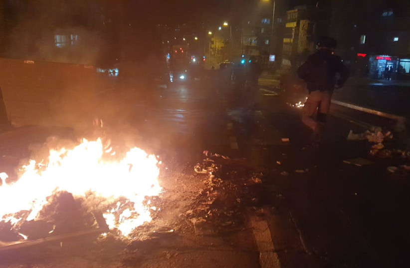 Haredi protesters burn garbage in protest of the light rail construction in their ultra-Orthodox neighborhood in Jerusalem, January 25, 2021.  (photo credit: POLICE SPOKESPERSON'S UNIT)