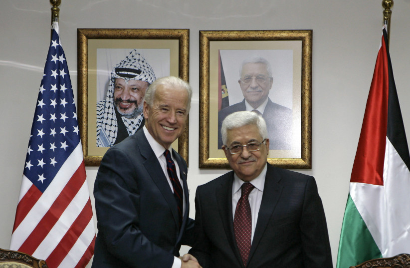 Then-vice president Joe Biden greets Palestinian Authority President Mahmoud Abbas in Ramallah on March 10, 2010. (photo credit: AMMAR AWAD/REUTERS)
