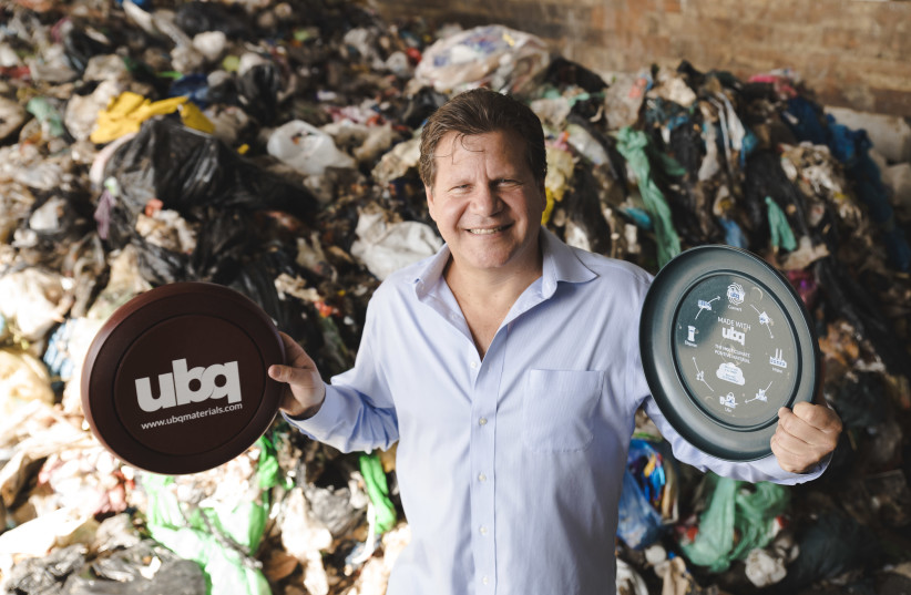 Jack (Tato) Bigio, UBQ Materials co-founder and CEO of UBQ Israel, holds plastic discs made from UBQ material. (photo credit: Courtesy)