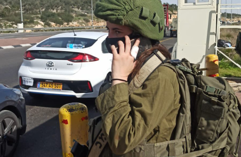 "Corporal ""L."" from the Home Front Command's Search and Rescue Unit following the stabbing attack on Tuesday, January 26, 2021. (photo credit: IDF SPOKESPERSON'S UNIT)"