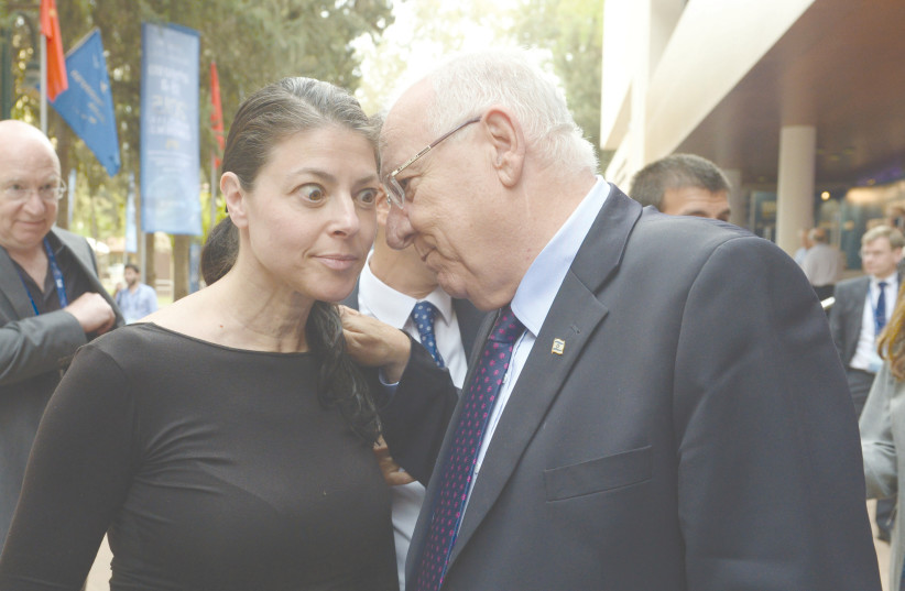 PRESIDENT REUVEN RIVLIN speaks with MK Merav Michaeli at the Herzliya Conference at the Interdisciplinary Center in 2015.  (photo credit: Mark Neiman/GPO)