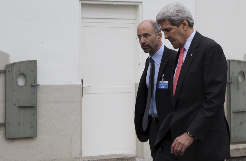 United States Secretary of State John Kerry walks to lunch with members his negotiating team, including Robert Malley (L) from the U.S. National Security Council, following a meeting with Iran's Foreign Minister Javad Zarif over Iran's nuclear program in Lausanne March 20, 2015 (photo credit: REUTERS)