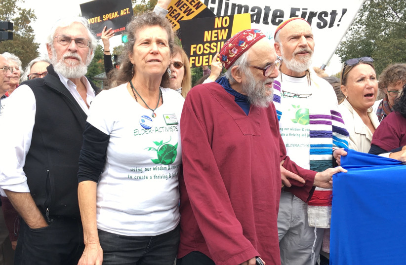 Rabbi Arthur Waskow, in red, at a climate protest in Philadelphia. (photo credit: MORDECHAI LIEBLING)