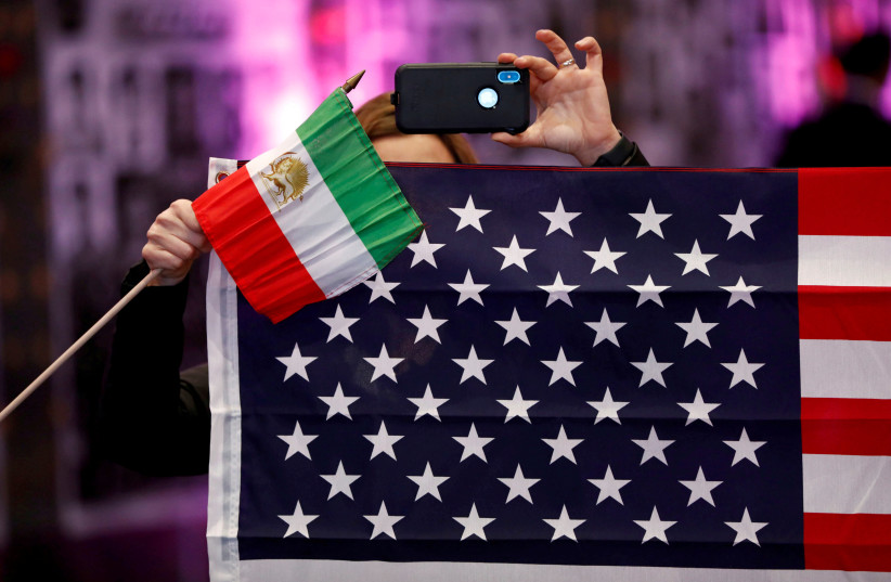 Flags from Iran and the United States  at the California Convention for a Free Iran, Los Angeles, US, January 11, 2020 (photo credit: REUTERS/PATRICK T. FALLON)