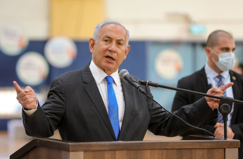 Prime Minister Benjamin Netanyahu is seen speaking at a COVID-19 vaccination center in Sderot, on January 27, 2021. (photo credit: LIRON MOLDOVAN/POOL)