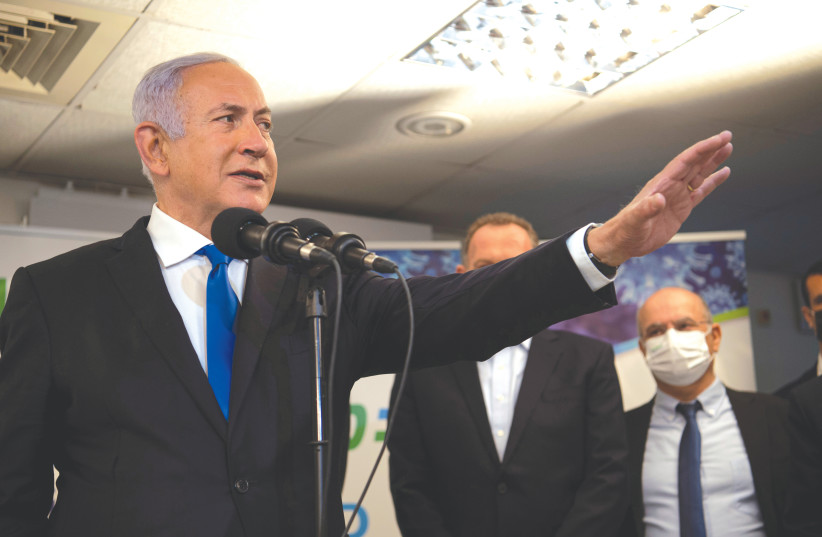 PRIME MINISTER Benjamin Netanyahu visits a coronavirus vaccination facility in Nazareth earlier this month. (photo credit: GIL ELIYAHU/REUTERS)