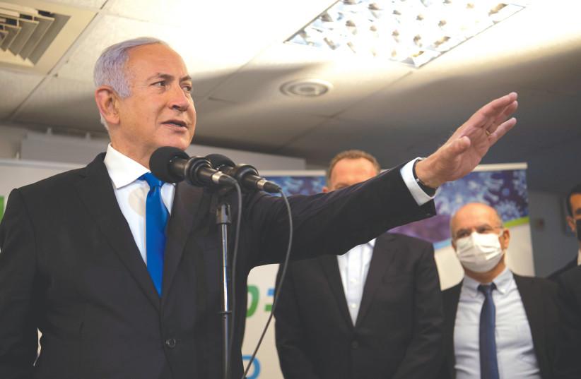 PRIME MINISTER Benjamin Netanyahu visits a coronavirus vaccination facility in Nazareth earlier this month. (photo credit: GIL ELIYAHU/REUTERS)