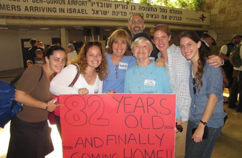 LEAH KLEIN, the writer's mother, is welcomed by her family as she makes aliyah (photo credit: PNINA WEISS PERETZ)