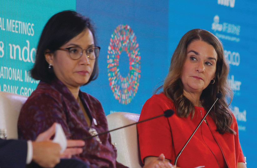 MELINDA GATES (right) and Indonesian Finance Minister Sri Mulyani Indrawati attend a seminar at the International Monetary Fund, 2018 (photo credit: REUTERS/JOHANNES P. CHRISTO)