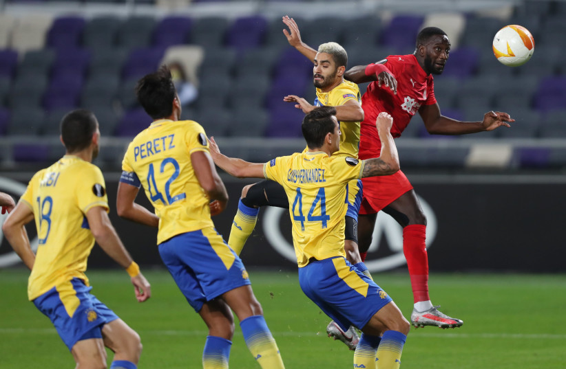 Maccabi Tel Aviv plays a Europa League soccer game at Bloomfield Stadium in their home city last year. The novel uses soccer as a vehicle to tell complex stories about Israeli society (photo credit: AMMAR AWAD / REUTERS)