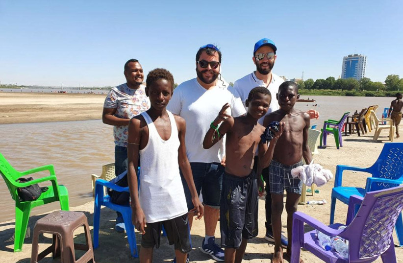 Having fun with some local Sudanese kids on the Nile River shores on Tuti Island in Khartoum (photo credit: Courtesy)